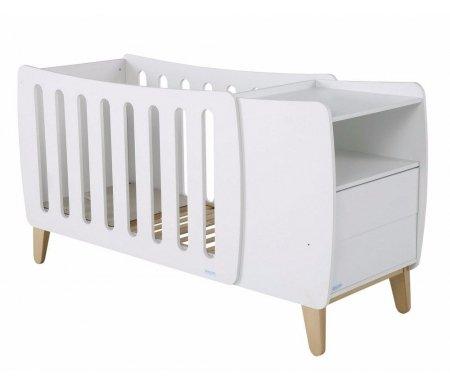 Кровать Micuna Harmony Evolutive Relax white / naturalКроватки для новорожденных<br>Испанские дизайнеры для тех, кто предпочитает креатив, представляют новое изделие – необычную по форме кроватку Harmony, которая радует современным видением интерьера, необычайно стильным и функциональным подходом в решении технических задач. В комплекс входит кроватка-трансформер в виде уютной колыбельки, а также тумба для хранения постельных принадлежностей и детских вещей. Весь комплект представляет собой компактную и многофункциональную конструкцию, удобную в пользовании.<br><br><br><br>Преимущества Relax:<br>  <br>- облегчает дыхание малыша при простуде;<br>  <br>- снижает риск удушья в случае срыгивания;<br>  <br>- снижает накопление газов;<br>  <br>- значительно снижает риск «синдрома внезапной смерти».<br><br><br><br>Основные характеристики:<br>  <br>- использование кроватки-трансформера в качестве спального места и колыбели и пеленального столика;<br>  <br>- трансформация кроватки в специальное пеленальное место для детей до одного года;<br>  <br>- изменение наклона ложа с помощью системы Relax;<br>  <br>- регулирование высоты ложа в одной из двух возможных позиций;<br>  <br>- использование в изделии закрытых шурупов, болтов и безопасных замков в движущихся деталях;<br>  <br>- отсутствие колесиков на ножках;<br>  <br>- наличие в комоде открытой полочки и двух ящиков (система «push» – для легкого открывания);<br>  <br>- в комплект входит матрасик для колыбели.<br>