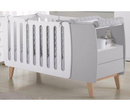 Кровать Micuna Harmony Plus Relax white / greyКроватки для новорожденных<br>Испанские дизайнеры для тех, кто предпочитает креатив, представляют новое изделие – необычную по форме кроватку Harmony, которая радует современным видением интерьера, необычайно стильным и функциональным подходом в решении технических задач. В комплекс входит кроватка-трансформер в виде уютной колыбельки, а также тумба для хранения постельных принадлежностей и детских вещей. Весь комплект представляет собой компактную и многофункциональную конструкцию, удобную в пользовании.<br><br><br><br>Преимущества Relax:<br>  <br>- облегчает дыхание малыша при простуде;<br>  <br>- снижает риск удушья в случае срыгивания;<br>  <br>- снижает накопление газов;<br>  <br>- значительно снижает риск «синдрома внезапной смерти».<br><br><br><br>Основные характеристики:<br>  <br>- использование кроватки-трансформера в качестве спального места и колыбели и пеленального столика;<br>  <br>- трансформация кроватки в специальное пеленальное место для детей до одного года;<br>  <br>- изменение наклона ложа с помощью системы Relax;<br>  <br>- регулирование высоты ложа в одной из двух возможных позиций;<br>  <br>- использование в изделии закрытых шурупов, болтов и безопасных замков в движущихся деталях;<br>  <br>- отсутствие колесиков на ножках;<br>  <br>- наличие в комоде открытой полочки и двух ящиков (система «push» – для легкого открывания);<br>  <br>- в комплект входит матрасик для колыбели.<br>